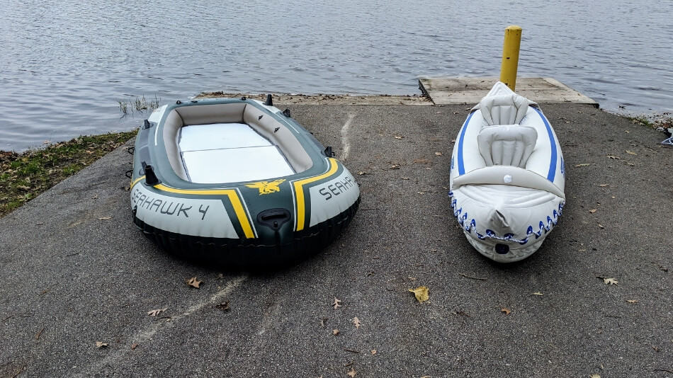 side by side comparison of an inflatable boat and an inflatable kayak