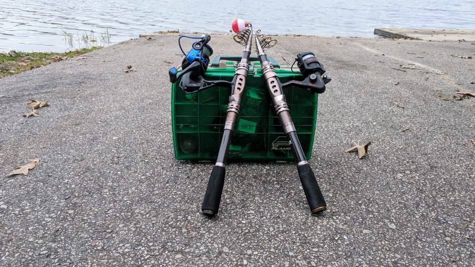 collapsible fishing poles with a tackle box on a boat landing