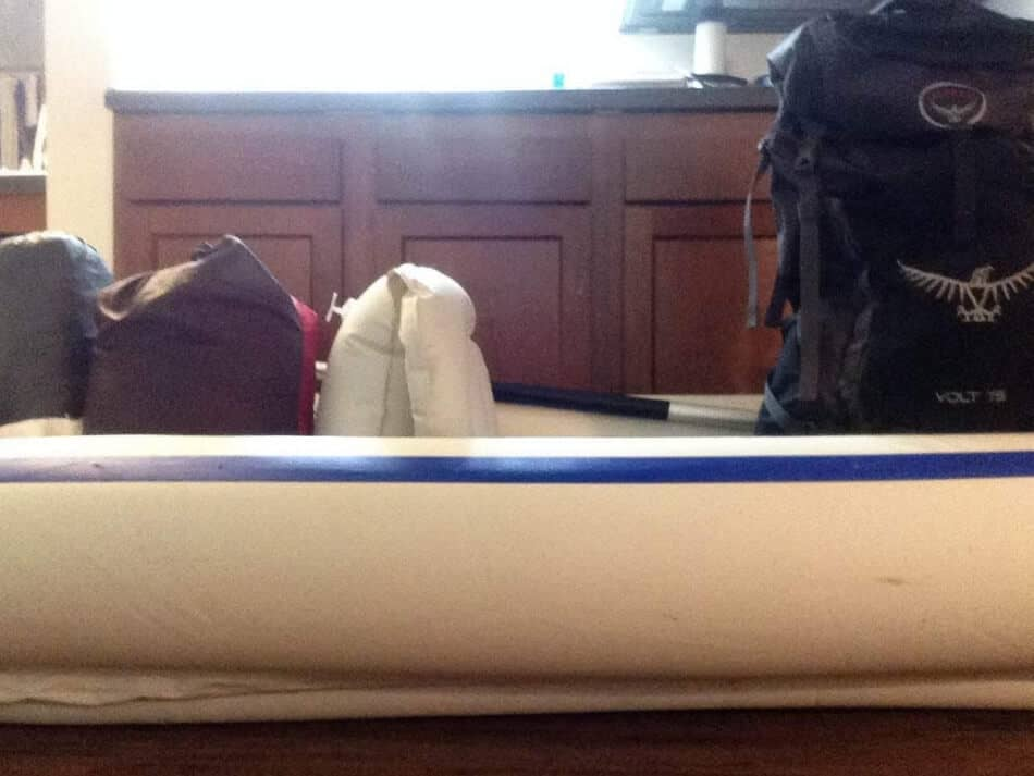 picture of an inflatable kayak with backpacking gear packed away