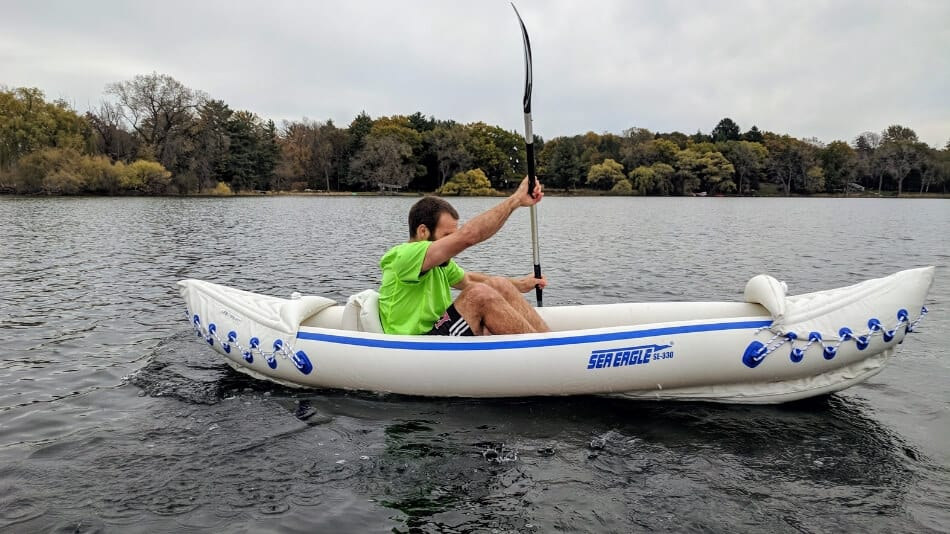 paddling an inflatable kayak on a lake in fall